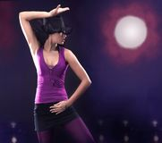 Dancing girl wearing a hat Royalty Free Stock Photography