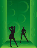 Dancing girls. In a dark green room Royalty Free Stock Image