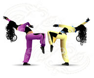 Dancing girls of the East. Dancing girls in oriental costumes in a dance pose against a light background Stock Photos