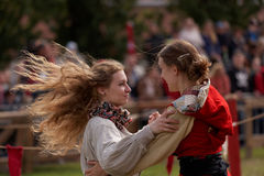 Dancing girls in medieval clothes Royalty Free Stock Photography