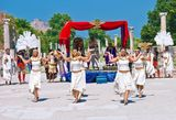 Dancing girls in old Ephesus. In the ancient city of Ephesus, local actors and dancers present a spectacular show for visitors. Dancing girsl in white togas play Royalty Free Stock Photography