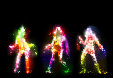 Dancing girls silhouettes, neon effect. Falling stars Stock Photography