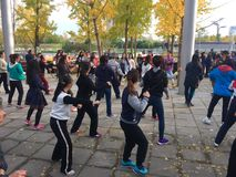 Dancing in group of Olympics park. People are dancing in group of Olympics park, beijing, china Stock Photo