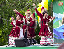 Dancing group in traditional dressing at Sabantuy. Sabantuy - national holiday celebrated in the present time many nations of the Volga and Southern Urals of royalty free stock images