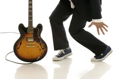 Dancing with guitar Stock Photos