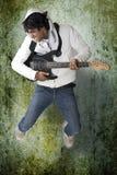 Dancing guitar player Royalty Free Stock Photos