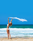 Dancing happy girl on the beach Royalty Free Stock Photos