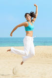 Dancing happy girl jumping fun Stock Photography