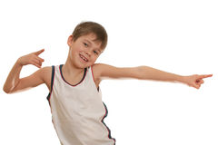 Dancing happy kid. A carefree kid is dancing; isolated on the white background Royalty Free Stock Photo