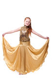 Dancing happy little girl in gold dress Stock Image
