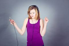 Dancing happy teenager girl listening to music Stock Photos