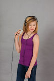 Dancing happy teenager girl listening to music Stock Image