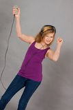 Dancing happy teenager girl listening to music Royalty Free Stock Images