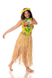 Dancing Hawaiian. A pretty preteen girl dancing barefoot in a grass skirt and Hawaiian leis Royalty Free Stock Photo