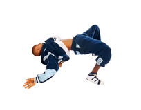 Dancing hip-hop young man on white Stock Photography