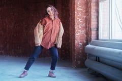 Dancing hipster girl royalty free stock image