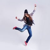 Dancing hipster girl in glasses and black beanie Stock Images