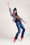 Dancing hipster girl in glasses and black beanie Royalty Free Stock Images
