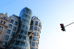 Dancing House in Prague. And the red light of traffic light Stock Photography