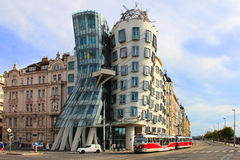 Dancing House in Prague with red tram in front Royalty Free Stock Images