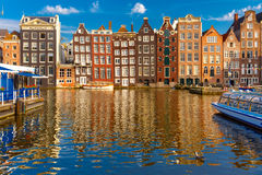 The dancing houses at Amsterdam canal Damrak, Holland, Netherlands. Royalty Free Stock Photo
