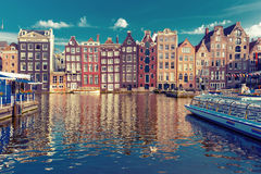 The dancing houses at Amsterdam canal Damrak, Holland, Netherlands. Stock Photo