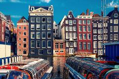 The dancing houses at Amsterdam canal Damrak, Holland, Netherlands. Royalty Free Stock Photography
