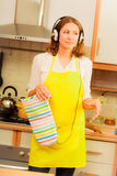 Dancing housewife in kitchen Stock Photos