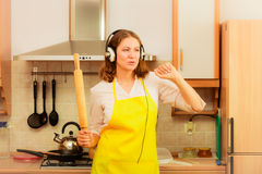 Dancing housewife in kitchen Royalty Free Stock Photography