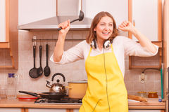 Dancing housewife in kitchen Royalty Free Stock Photo