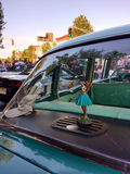 Dancing Hula Girl in the Window of a Classic Car Royalty Free Stock Photo