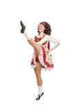 Dancing irish dance. Young woman in irish dance kick up her leg isolated Royalty Free Stock Photo