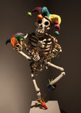 Dancing jester skeleton paper mache Stock Photo