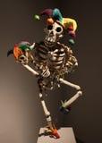 Dancing jester skeleton paper mache Stock Photo
