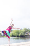 Dancing Joy: Beautiful Blond Young Slim Woman Enjoying Stretching In Long Light Dress At Water Lake On Summer Green Outdoors Stock Photography