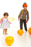 Dancing kids at Halloween party. With balloons around them Royalty Free Stock Photos