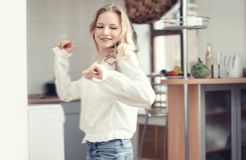 Dancing at the kitchen Stock Image