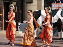 Dancing Krishna Consciousness. Dancing girls Krishna Consciousness in Indian clothes on Arbat Street in Moscow stock photos