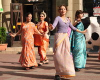 Dancing Krishna Consciousness. Dancing girls Krishna Consciousness in Indian clothes on Arbat Street in Moscow stock photo