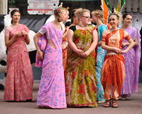 Dancing Krishna Consciousness. Dancing girls Krishna Consciousness in Indian clothes on Arbat Street in Moscow royalty free stock images