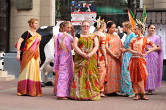 Dancing Krishna Consciousness. Dancing girls Krishna Consciousness in Indian clothes on Arbat Street in Moscow stock photography