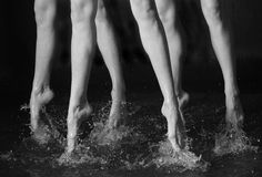 Dancing legs. In the water (black & white Royalty Free Stock Images