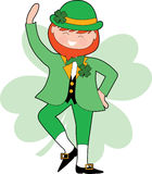 Dancing Leprechaun. With a green Shamrock background Royalty Free Stock Photography