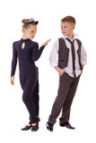 Dancing little girl dressed as a cat and a boy in a plaid vest Stock Photo
