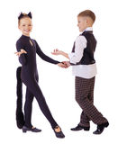 Dancing little girl dressed as a cat and a boy in a plaid vest Stock Images