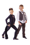 Dancing little girl dressed as a cat and a boy in a plaid vest Royalty Free Stock Image