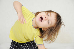 Dancing little girl having fun isolated, happy childhood concept, positive expressing emotion Stock Photos