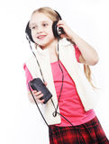 Dancing little girl headphones music singing on white background Royalty Free Stock Photography