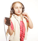 Dancing little girl headphones music singing on white background Stock Photo