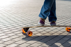 Dancing on longboard. A girl's legs dancing on longboard stock images